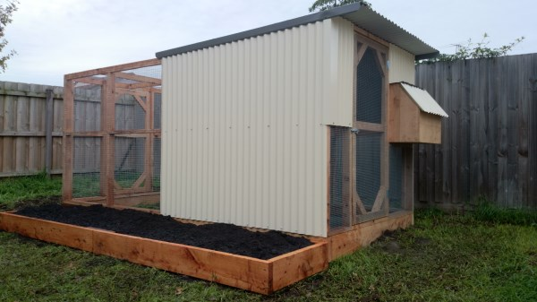 2 Tier chookhouse with raised veggie bed along side by Yummy Gardens Melbourne