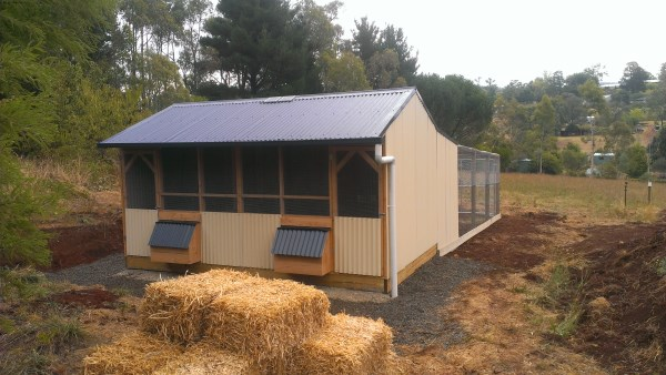Divided chicken home with solar power door opener & large rear run designed & built by Yummy Gardens Melbourne