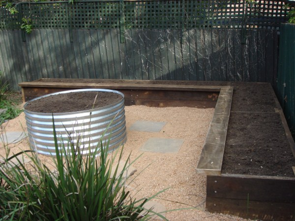 ironbark L shaped raised garden bed & earth ring by Yummy Gardens Melbourne