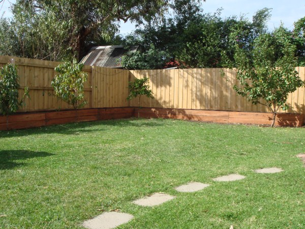 L shaped raised beds and fruit trees by Yummy Gardens Melbourne