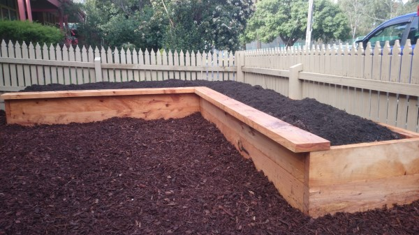 Lshaped veggie bed in front yard by Yummy Gardens Melbourne