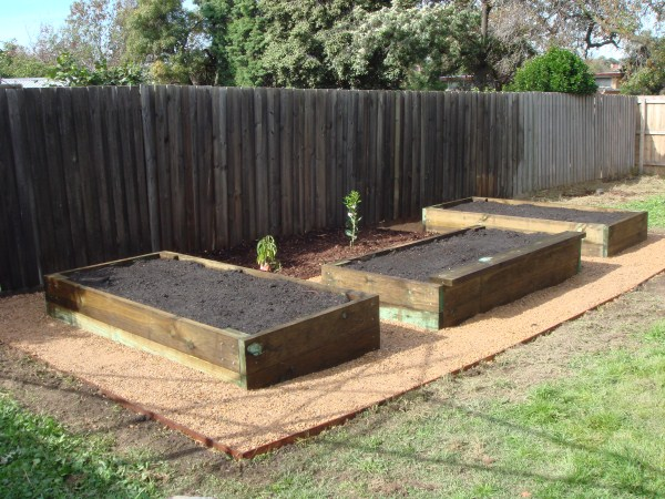 new raised vegie beds and fruit trees by Yummy Gardens Melbourne