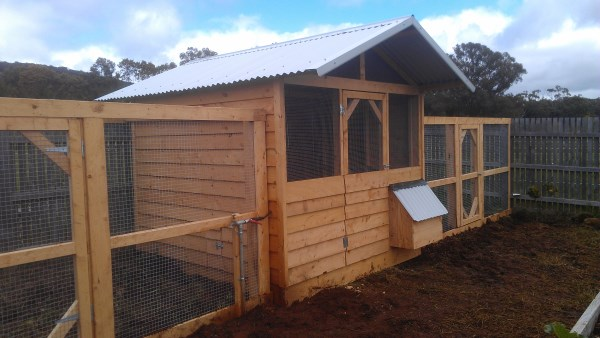 Timber chook house with dual runs by Yummy Gardens Melbourne