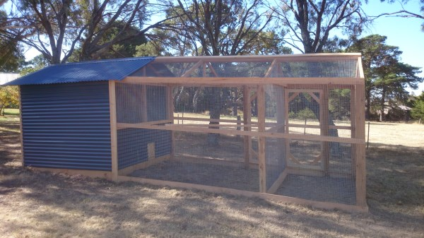 Chicken house with divided pitched roof run by Yummy Gardens Melbourne