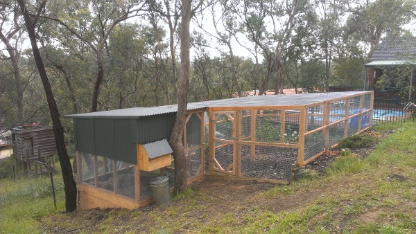 Chook house and large secure run built on slope by Yummy Gardens Melbourne