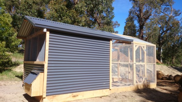 Colour bond chook house with rear enclosed pitched roof run by Yummy Gardens Melbourne