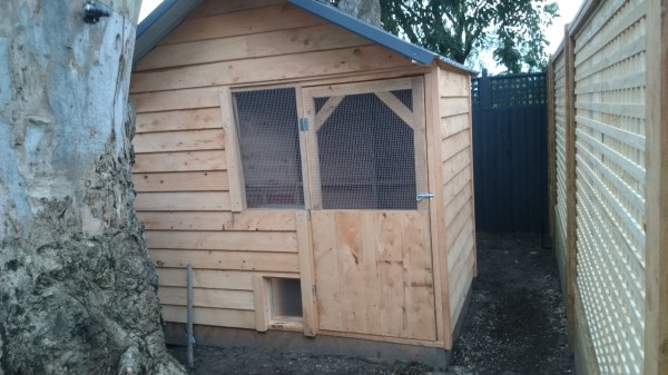 Cypress chicken house with solar door by Yummy Gardens Melbourne