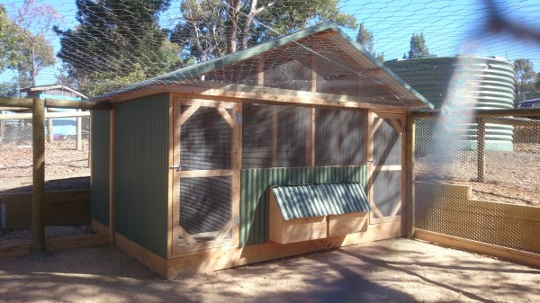 Double sided pitched roof chicken house in enclosed run by Yummy Gardens Melbourne