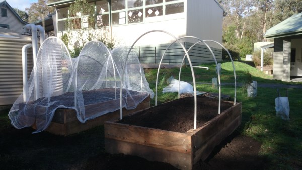 Hooped & covered raised veggie beds in school by Yummy Gardens Melbourne