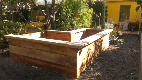 L-shape veggie bed with seating designed & built by Yummy Gardens Melbourne