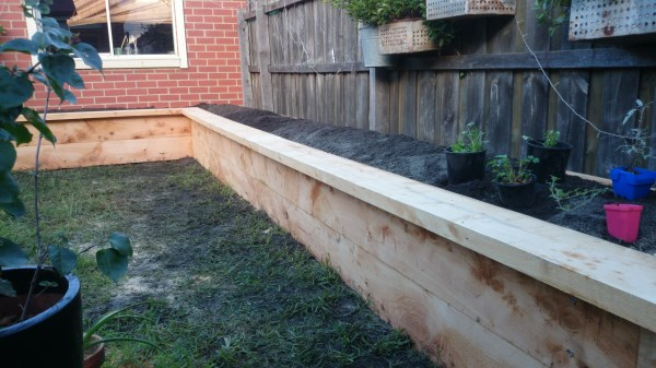 Lshaped raised veggie bed along fence by Yummy Gardens Melbourne