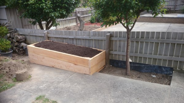 Raised veggie bed on sloping site by Yummy Gardens Melbourne